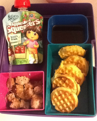 bento breakfast: applesauce, mini waffles with syrup, turkey sausage